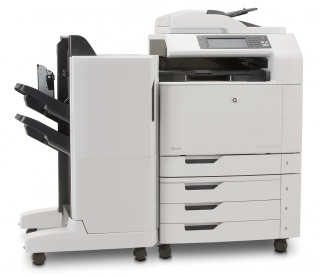 На фото МФУ HP Color LaserJet CM6030